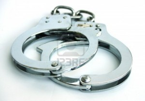 4009265-empty-metal-handcuffs-isolated-on-a-white-background